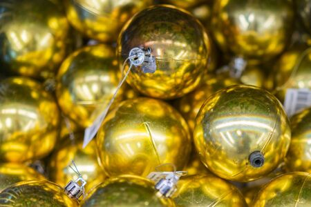 Christmas decorations in boxes. Balls for the Christmas tree of golden light. Christmas preparation concept. Christmas background for cards and congratulations. Stock fotó