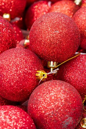 Red christmas balls. Christmas toys background for a Christmas card, Christmas wallpapers. vertical photo. Stock fotó - 134654676