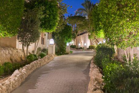 Night street of the old stone city with beautiful lanterns. empty night street. Stock fotó