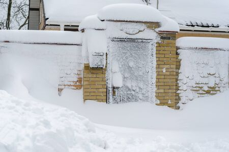 The entrance is covered with snow. Stock fotó