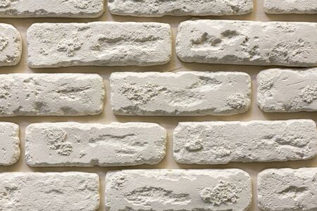 Gray wall background of concrete block texture. plaster decorative brick.
