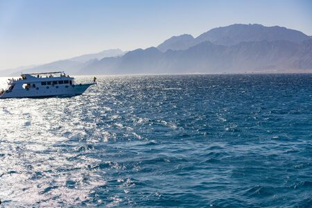 White yacht on a background of mountains. concept of sea recreation and tourism. Stock fotó - 134657010