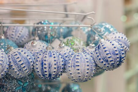 blue christmas balls in the store for decoration. Christmas concept.