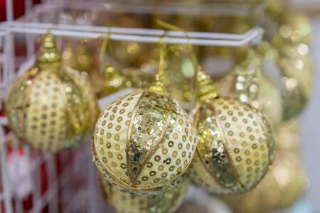 Yellow Christmas balls in a New Years store. Christmas toys background for a Christmas card, Christmas wallpapers. Stock fotó