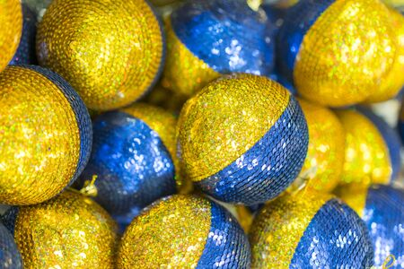 yellow-blue Christmas balls to decorate the Christmas tree. Christmas concept. Christmas background.