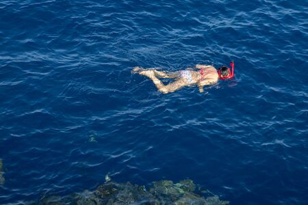 People at sea do snorkeling. Sea vacation concept.