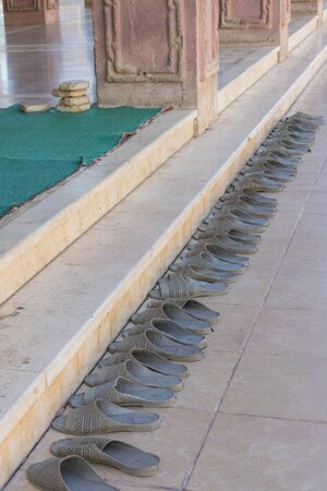 Shoes outside the door of a mosque in Sharm El Sheikh. Islamic faith concept. vertical photo