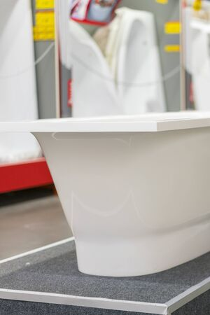 White bathtubs in a hardware store. vertical photo.