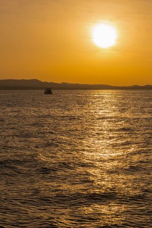 Sunset at sea. copy space. vertical photo. toned.