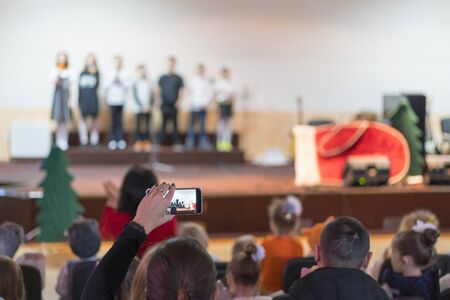 Children at school perform on stage in front of parents. Young talents on stage. blurry. Stock fotó