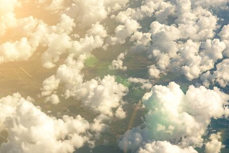 Beautiful landscape aerial view of Above The Clouds in the sky. The rays of the sun in the clouds. toned.