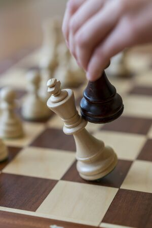 playing wooden chess pieces. Chess game. The fall of the king. Vertical photo. Stock fotó