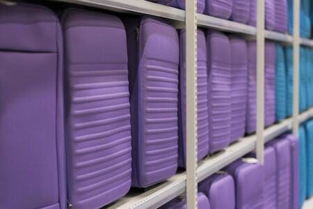 purple suitcases on a shelf in a store. Travel concept. Stock fotó