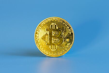Bitcoin coin on a blue background.