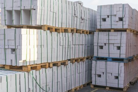 Construction Materials. Building materials for construction of residential complex. Pile of white bricks at construction site. Stock fotó