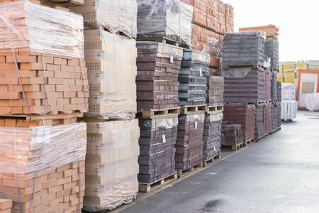 clay brick stored for building construction. Industrial production of bricks. brick production line in factory, stacked bricks.