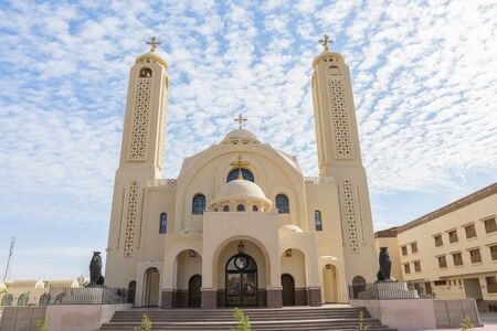Coptic Orthodox Church in Sharm El Sheikh, Egypt.Against the backdrop of a beautiful sky with clouds. All Saints Church. Concept of the righteous faith. Stock fotó - 138046749