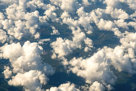 Beautiful landscape aerial view of Above The Clouds in the sky. The rays of the sun in the clouds. Фото со стока