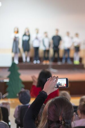 Children at school perform on stage in front of parents. Young talents on stage. vertical photo. blurry. Stock fotó - 138060877