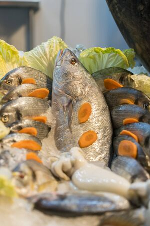 Fresh sea fish in ice at the market. healthy seafood. vertical photo. Stock fotó - 138061422