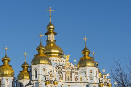 Orthodox temple with golden baths on a blue background. The concept of Orthodoxy. Фото со стока