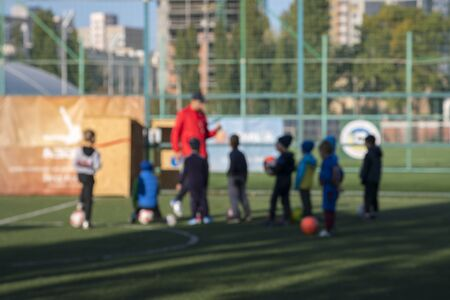 Boys at a football training. The concept of a healthy lifestyle and sport. Blurry.