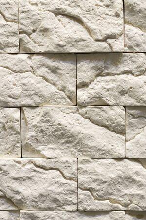 Gray decorative stone background. Gray wall background of concrete block texture. vertical photo. Фото со стока