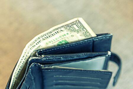 Empty male wallet with one dollar bill. financial wellness. copy space. Stock fotó - 138062770