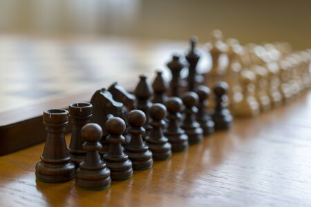 Chess pieces in front of a chessboard. Stock fotó - 138064081