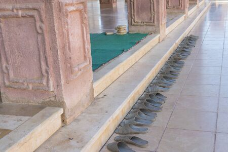 Shoes outside the door of a mosque in Sharm El Sheikh. Islamic faith concept.