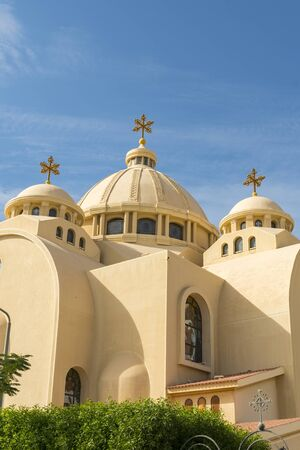 Coptic Orthodox Church in Sharm El Sheikh, Egypt. All Saints Church. Concept of the righteous faith. The concept of Orthodoxy. vertical photo.