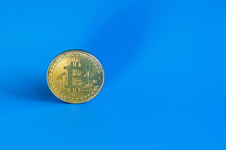 Bitcoin coin on a blue background. copy space.