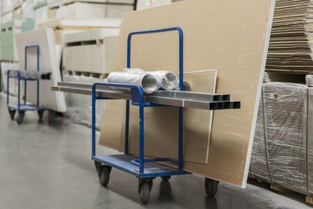Trolley in a hardware store loaded with construction materials. Repair and construction concept.