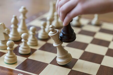 playing wooden chess pieces. Chess game. The fall of the king. Stock fotó