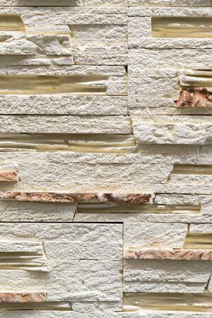 Beige decorative stone for decoration. Beige Stone Background. vertical photo.