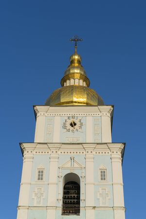 Orthodox bell tower against the blue sky in the sun. The concept of the Orthodox faith. Vertical photo. Stock fotó