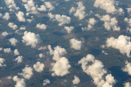Beautiful landscape aerial view of Above The Clouds in the sky. The rays of the sun in the clouds. Stock fotó