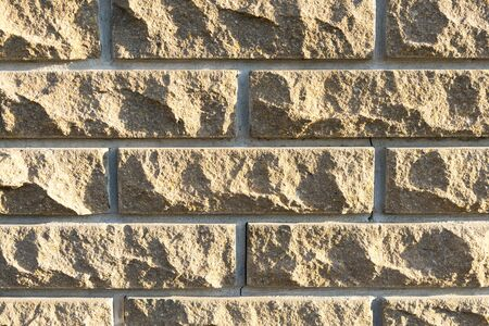 Wall of brown brick. close-up. background