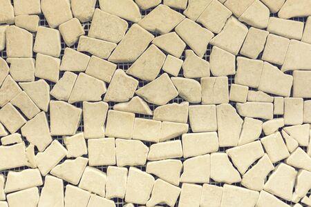 porcelain mosaic beige background texture. Ceramic tiles for decoration. Beige color. Beige decorative mosaic for decoration. background. toned.