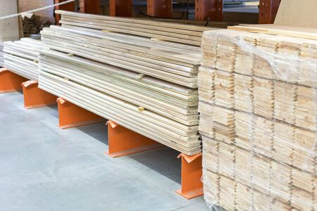 Many wooden planks in hardware store. Stacks of wooden planks at building materials store. Boards in a hardware store. Repair and construction concept. Stock fotó