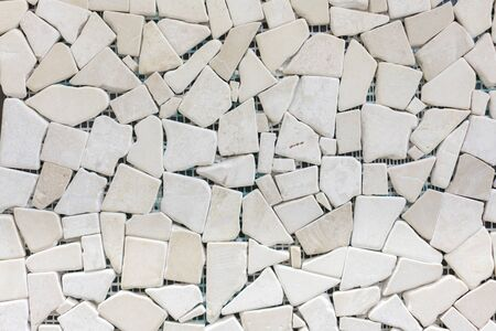 porcelain mosaic beige background texture. Ceramic tiles for decoration. Beige color. Beige decorative mosaic for decoration. background.