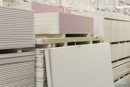 Drywall in a hardware store. Drywall sheets for repair and construction. Repair and construction concept.