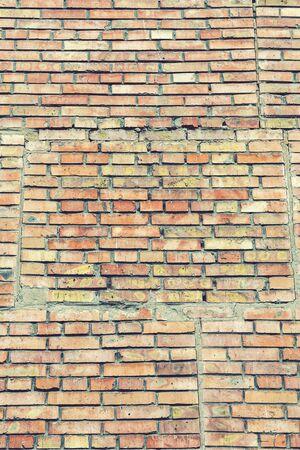 Old orange brick wall. vertical photo. background.