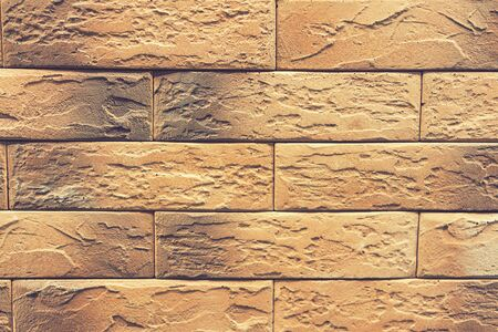 Brick orange wall, brick background. close up. toned.