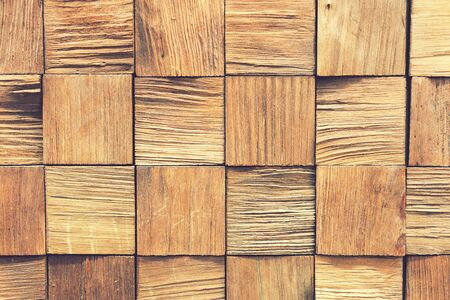 Background of wooden boards. wooden background - square format. pieces of teak wood stump background. wooden panel materials for different purposes, note shallow depth of field. toned.