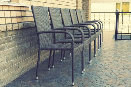Empty brown chairs on the terrace. pandemic and social exclusion concept. toned. 免版税图像 - 149159109