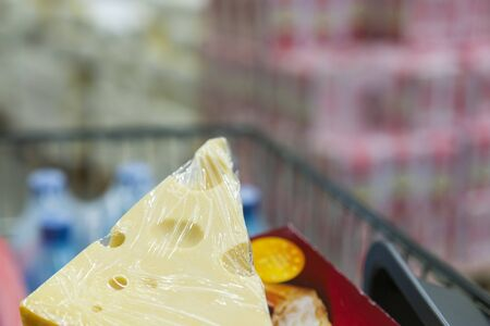 Cheese in a shopping cart. copy space.