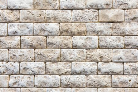 Decorative stone for decoration of the fireplace. Brick orange wall, brick background. close up. Background.