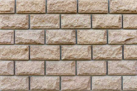 Wall of brown brick. close-up. background.