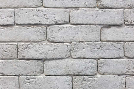 Seamless texture of white decorative stacked stone, natural stone cladding. brick background. close up. Background